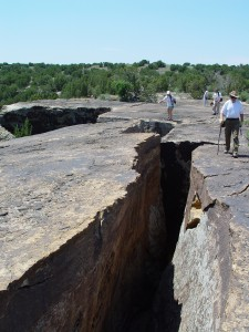 A large section of Dakota Formation slumping away from the main block provides a dramatic hiking experience