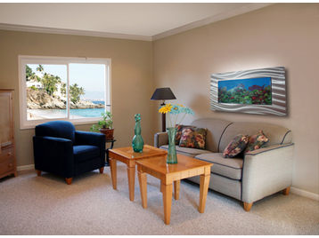 Room featuring a wall-mounted aquarium.